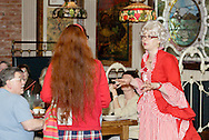 """Mrs. Claus (aka Tamra Francis) talks with the Claus' new assistant Penelope (aka Jenna Rebbin Shaw) during Mayhem & Mystery's production of """"I'll Be Home Shopping for Christmas"""" at the Spaghetti Warehouse in downtown Dayton, Monday, November 9, 2009."""