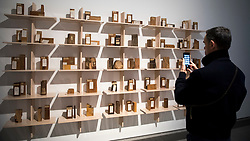 "© Licensed to London News Pictures. 03/03/2020. LONDON, UK. A staff member views wood samples from the storage spaces of the V&A. Preview of ""Cambio"" by Formafantasma, an Italian design duo based in Amsterdam.  The exhibition is an ongoing investigation into the governance of the timber industry and takes place at the Serpentine Sackler Gallery 4 March to 17 May 2020.  Photo credit: Stephen Chung/LNP"