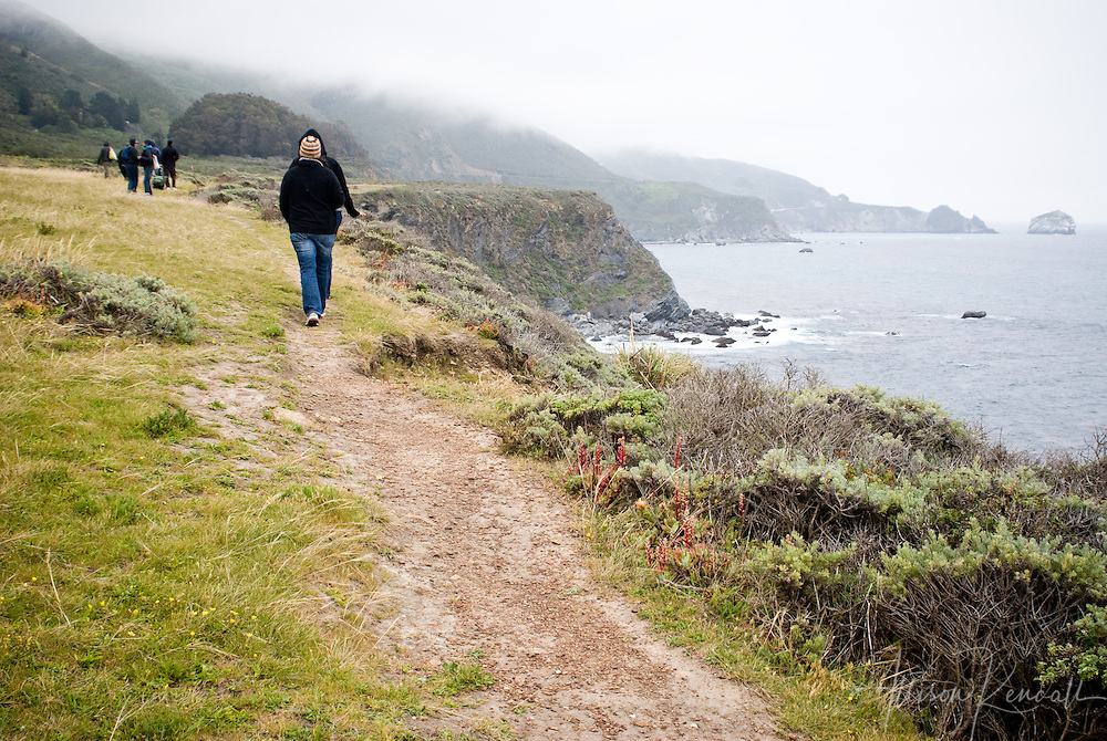 Hikers follow a trail along the misty cliffs of Big Sur, near Jade Cove
