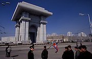 The Triumphal Arch, Pyongyang. The North Koreans boast it is larger than the Arc du Triomphe in Paris. Spectators watch an endurance race of teenage boys and girlls.Pyongyang, North Korea, DPRK