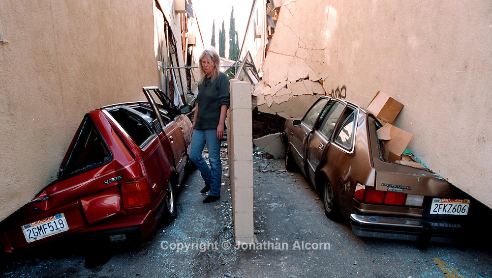 Northridge earthquake apartment building collapse destroys cars on January 17, 1994.
