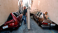 Northridge earthquake apartment building collapse destroys cars on January 17, 1994.