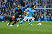Manchester City's David Silva on the ball during the Champions League match between Manchester City and Real Madrid at the Etihad Stadium, Manchester, England on 26 April 2016. Photo by Shane Healey.