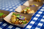 Salvatore's smoke and braised piri pier pork with grilled sweet corn and summer vegetables during the 4th annual Yum Yum Fest held at Breese Stevens Field, Sunday, August 6, 2017.