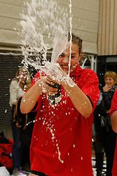 21-04-2012 VOLLEYBAL: B- LEAGUE DAMES VCN KING SOFTWARE - KINDERCENTRUM ALTERNO 2: CAPELLE AAN DEN IJSSEL <br /> Leanne Verdonck, dochter van Heleen Crielaard, spuit met de champagne<br /> ©2012-FotoHoogendoorn.nl / Pim Waslander