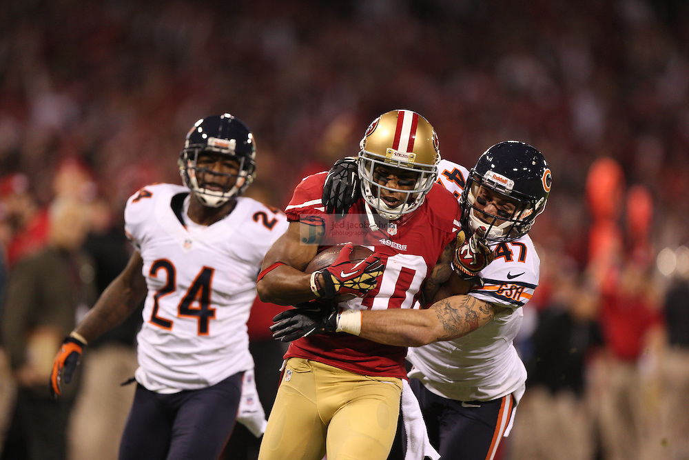 San Francisco 49ers wide receiver Kyle Williams (10) catches a pass against the Chicago Bears cornerback Kelvin Hayden (24) and safety Chris Conte (47) during an NFL game on Monday Nov. 19, 2012 in San Francisco, CA.  (photo by Jed Jacobsohn)