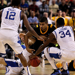 Mar 19, 2011; Tampa, FL, USA; West Virginia Mountaineers guard Casey Mitchell (3) collides with Kentucky Wildcats guard DeAndre Liggins (34) and guard Jon Hood (left) while scrambling for a ball during the first half of the third round of the 2011 NCAA men's basketball tournament at the St. Pete Times Forum.  Mandatory Credit: Derick E. Hingle