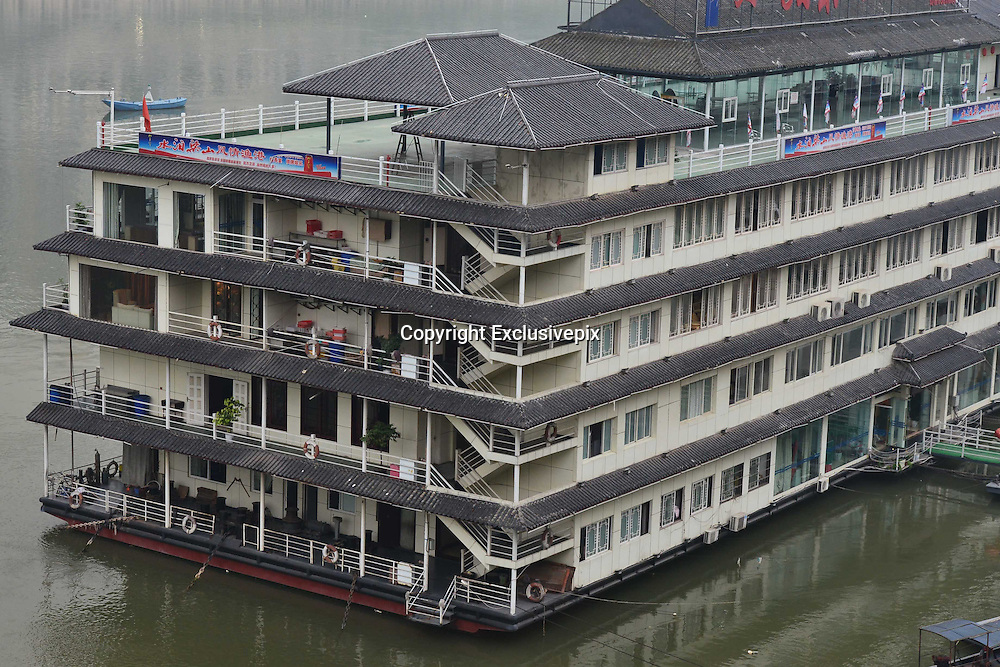 CHONGQING, CHINA - JUNE 04: (CHINA OUT) <br /> <br /> A general view of a five-floor luxury hotel boat which looks like a building on water at Jialing River on June 4, 2014 in Chongqing Province of China. The hotel boat includes the service of observation elevator, hotel room, chess entertainment, wild fish feast etc. <br /> ©Exclusivepix