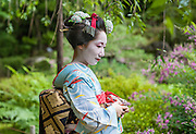 Geisha visiting Heian Shrine Garden in Kyoto (Japan).