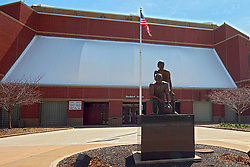 19 April 2014:   Redbird Arena, exterior.  North facade with Will Robinson - Doug Collins statue visible.<br /> <br /> This image was produced in part utilizing High Dynamic Range (HDR) or panoramic stitching processes.  It should not be used editorially without being listed as an illustration or with a disclaimer.  It may or may not be an accurate representation of the scene as originally photographed and the finished image is the creation of the photographer.