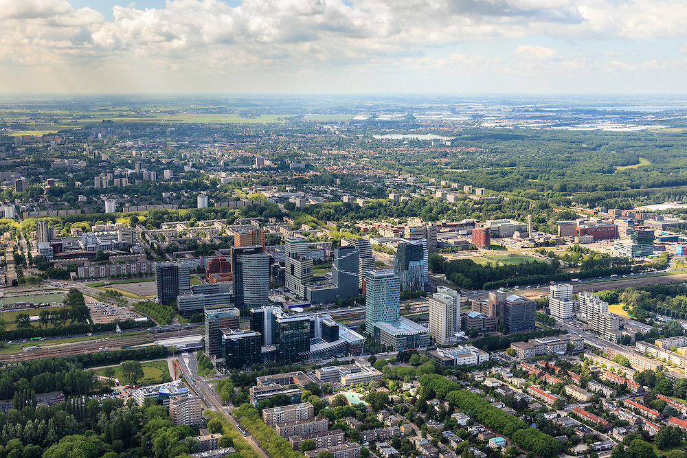 Nederland, Noord-Holland, Amsterdam, 14-06-2012; ZIcht op ring A10, de Zuidas en Prinses Irenebuurt, Buitenveldert en  Amsterdamse Bos in de achtergrond...View on financial district of Amsterdam in southern direction. The A10 ringroad runs between the high-rise offices.  The Amsterdamse Bos (a park layed out in the 30s of the 20th century) right..luchtfoto (toeslag), aerial photo (additional fee required).foto/photo Siebe Swart