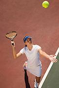 Woman Serving Tennis Ball
