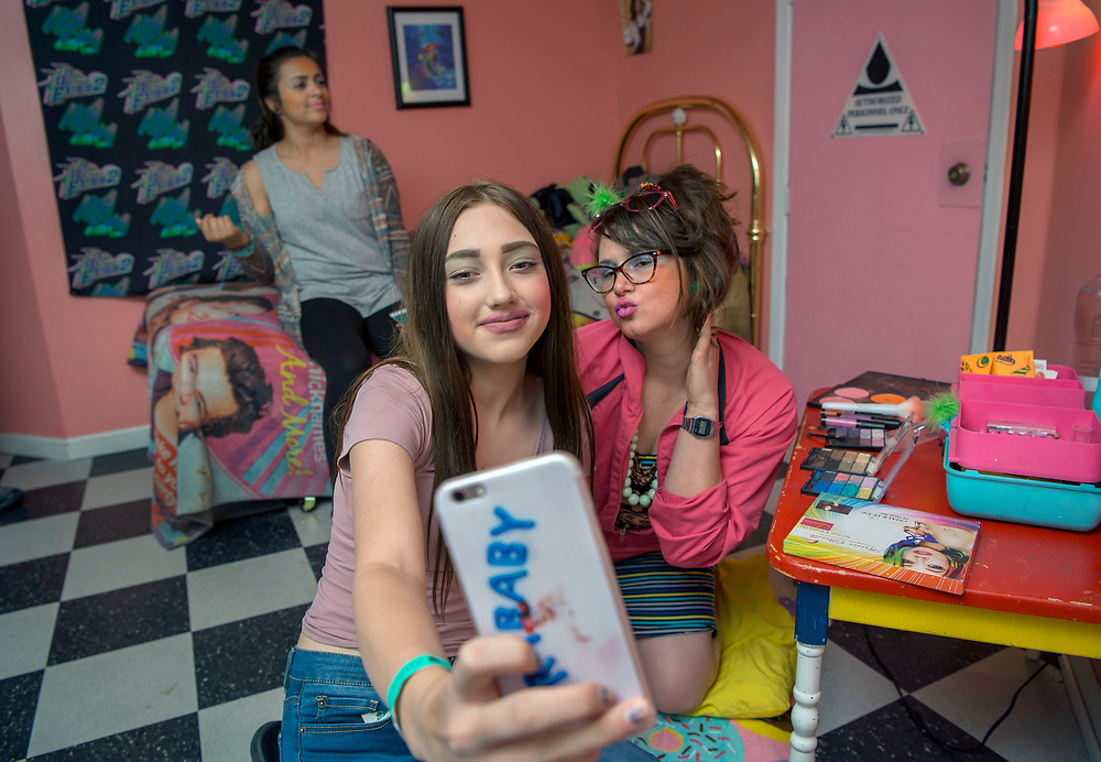 em053117c/jnorth/Mayah Medina, 12, left, Jacklin Gallegos, 12, center, both from Santa Fe, have a makeover with Charlotte Thurman, as Sassy, at Meow Wolf's House of Eternal Return in Santa Fe Wednesday May 31, 2017. Thurman is part of Meow Wolf's Summer in the Multiverse and does a makeover/slumber party act.  (Eddie Moore/Albuquerque Journal