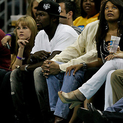 April 22, 2011; New Orleans, LA, USA; Rapper 50-Cent watches courtside during the first half in game three of the first round of the 2011 NBA playoffsbetween the New Orleans Hornets and the Los Angeles Lakers at the New Orleans Arena. The Lakers defeated the Hornets 100-86.   Mandatory Credit: Derick E. Hingle