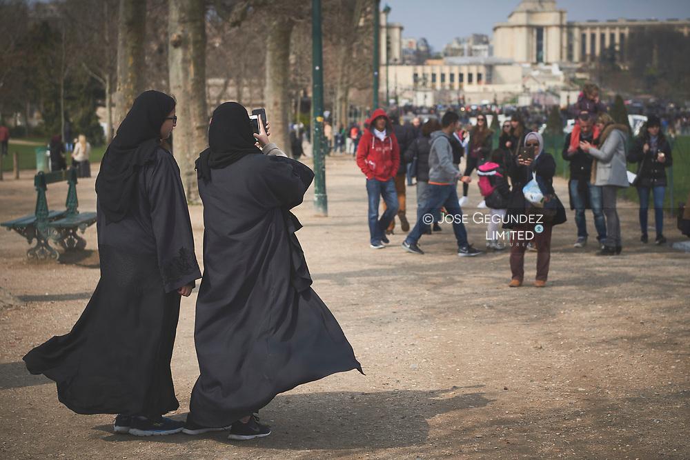 Women make selfies under Eiffel tower