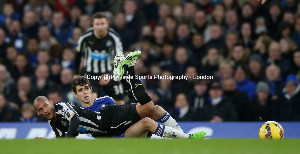 10 January 2015 Premier League Football - Chelsea v Nerwcastle United ;  Yoan Gouffran of Newcastle and Oscar of Chelsea keep their eyes on the loose ball.<br /> Photo: Mark Leech