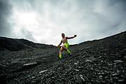 Logan Rachow of Eagle River, AK, picks his way down the scree slope.