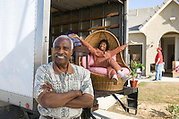 Portrait of middleaged couple, lady on lorry