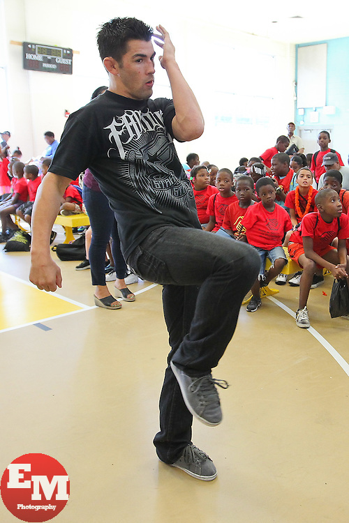 August 4, 2011; Philadelphia, PA; USA; Dominick Cruz speaks to children at the Boys & Girls Club in Philadelphia.