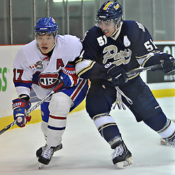 TORONTO, ON - Nov 10: Ontario Junior Hockey League game between Toronto Jr. Canadiens and Toronto Lakeshore Patriots. Jimin Kim #17 of the Toronto Junior Canadiens and Alex D Oliveira #51 of the Toronto Lakeshore Patriots battle for the puck during first period game action..(Photo by Shawn Muir / OJHL Images)