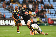 Wasps fullback Juan De Jongh (23) breaks a tackle during the Gallagher Premiership Rugby match between Wasps and London Irish at the Ricoh Arena, Coventry, England on 20 October 2019.