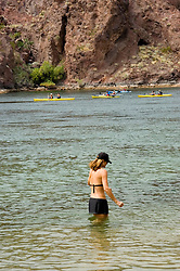 Swimming and kayaking, no model release, on the Colorado River below Hoover Dam on border of Arizona, AZ, Nevada, NV, tourism, vacation, sports, action, image nv416-18669.Photo copyright: Lee Foster, www.fostertravel.com, lee@fostertravel.com, 510-549-2202