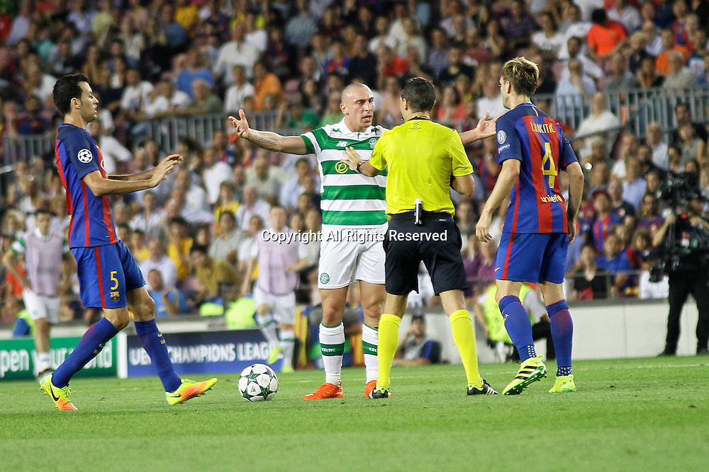 13.09.2016. Nou Camp, Barcelona, Spain. UEFA Champions League Football. Barcelona versus Celtic.  Brown discusses the decision with Rakitic and the Referee