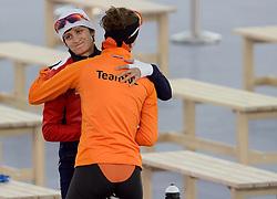 09-02-2014 SCHAATSEN: OLYMPIC GAMES: SOTSJI<br /> Ireen Wüst reed in de Adler Arena op de 3000 meter naar goud. Martina Sablikova wenst Ireen succes op de 3000 meter. Sablikova pakte het zilver<br /> ©2014-FotoHoogendoorn.nl<br />  / Sportida