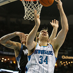 February 7, 2011; New Orleans, LA, USA; New Orleans Hornets center Aaron Gray (34) is fouled from behind by Minnesota Timberwolves power forward Michael Beasley (8) during the second quarter at the New Orleans Arena.   Mandatory Credit: Derick E. Hingle