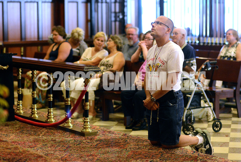 PSHRINE07P<br /> An man, who declined to be identified, prays in the lower church during the 50th annual Polish American family festival and country fair at the National Shrine of Our Lady of Czestochowa Sunday September 6, 2015 in Doylestown, Pennsylvania.  (William Thomas Cain/For The Inquirer)