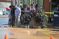 A water line breaks at the intersection of Van Buren and South Lamar in front of Square Books in Oxford, Miss. on Saturday, June 12, 2010.