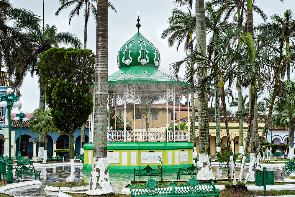 The brightly painted 19th-century kiosk designed by local sculptor Francisco Sanchez Terán in the Plaza Zaragoza in Tlacotalpan, Veracruz, Mexico. The tiny town is painted a riot of colors and features well preserved colonial Caribbean architectural style dating from the mid-16th-century.