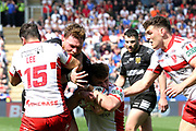 Hull FC prop forward Scott Taylor (8) is tackled by Hull Kingston Rovers utility player Tommy Lee (15)  during the Betfred Super League match between Hull FC and Hull Kingston Rovers at Kingston Communications Stadium, Hull, United Kingdom on 19 April 2019.