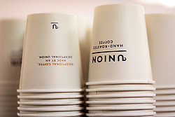 © Licensed to London News Pictures. 07/04/2016. Disposable paper coffee cups on display at The London Coffee Festival. Now its 4th year, will attract over 35,00 visitors over the four day event. London, UK. Photo credit: Ray Tang/LNP