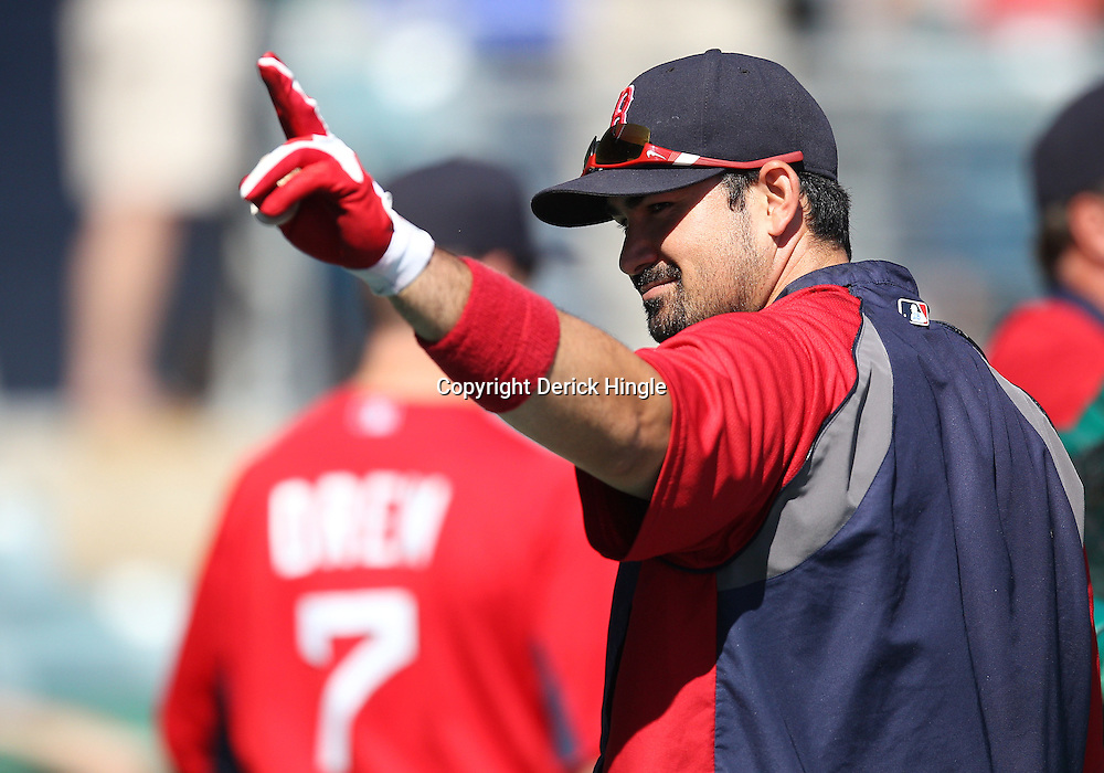 March 12, 2011; Fort Myers, FL, USA; Boston Red Sox first baseman Adrian Gonzalez (28) before a spring training exhibition game against the Florida Marlins at City of Palms Park.   Mandatory Credit: Derick E. Hingle