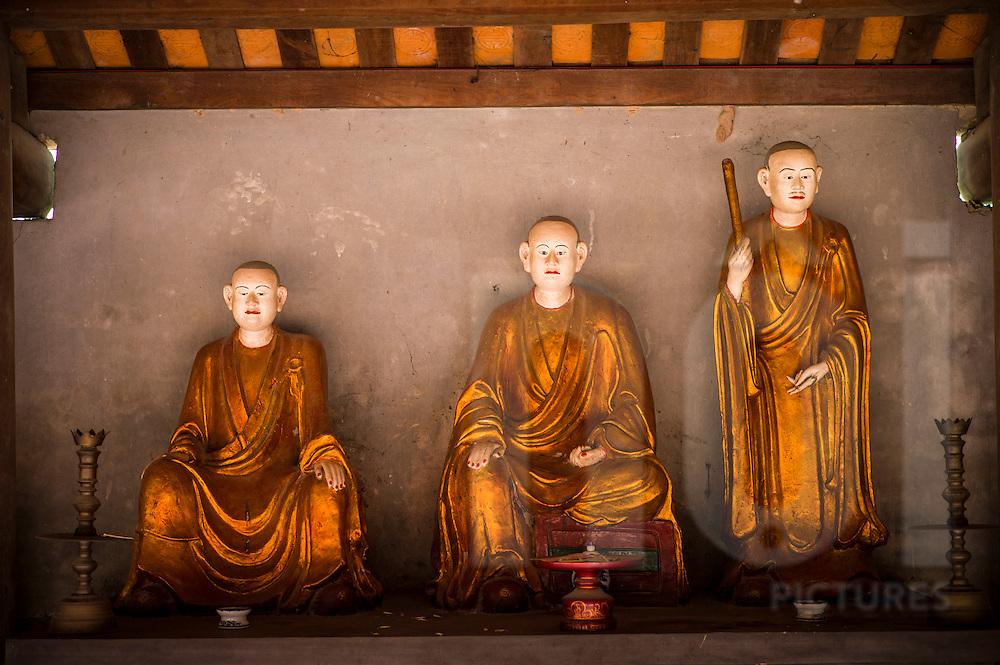 Dummies in buddhist pagoda Dau, Vietnam, Southeast Asia