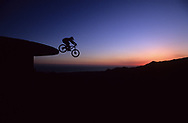 A man jumps his mountain bike off a water storage tower near Santa Barbara, California.