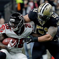 Dec 24, 2017; New Orleans, LA, USA; New Orleans Saints middle linebacker Manti Te'o (51) tackles Atlanta Falcons running back Tevin Coleman (26) during the first quarter at the Mercedes-Benz Superdome. Mandatory Credit: Derick E. Hingle-USA TODAY Sports