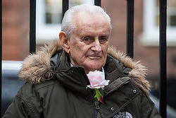 London, UK. 6 December, 2019. Peter Cole, 76, a climate change activist from Extinction Rebellion, stands outside the Conservative party headquarters on the 19th day of a Global Hunger Strike for Climate Justice intended to apply pressure on political parties to place the climate and ecological emergency at the centre of their general election campaigning.