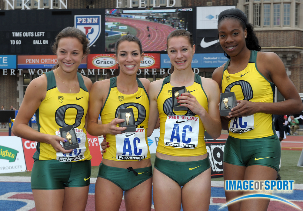 Apr 28, 2012; Philadelphia, PA, USA; Members of the Oregon womens 4 x 800m relay team pose after winning the Championship of America race in 8:24.16 in the 118th Penn Relays at Franklin Field. From left: Laura Roesler and Becca Friday and Anne Kesselring and Claudia Francis.