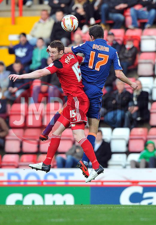 Bristol City's Stephen Pearson battles for the high ball with Blackpool's Chris Basham - Photo mandatory by-line: Joe Meredith/JMP  - Tel: Mobile:07966 386802 17/11/2012 - Bristol City v Blackpool - SPORT - FOOTBALL - Championship -  Bristol  - Ashton Gate Stadium -