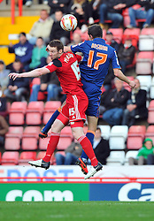 Bristol City's Stephen Pearson battles for the high ball with Blackpool's Chris Basham - Photo mandatory by-line: Joe Meredith/JMP  - Tel: Mobile:07966 386802 17/11/2012 - Bristol City v Blackpool - SPORT - FOOTBALL - Championship -  Bristol  - Ashton Gate Stadium -