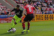 forward Vadaine Oliver takes on defender Jamie McAllister during the Sky Bet League 2 match between Exeter City and York City at St James' Park, Exeter, England on 22 August 2015. Photo by Simon Davies.