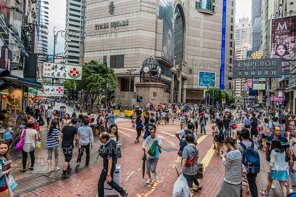 Causeway Bay, Hong Kong, China- June 7, 2014: people walking in the street outside Times Square