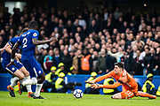 Chelsea (13) Thibaut Courtois, dives to make a save from a shot during the Premier League match between Chelsea and West Ham United at Stamford Bridge, London, England on 8 April 2018. Picture by Sebastian Frej.