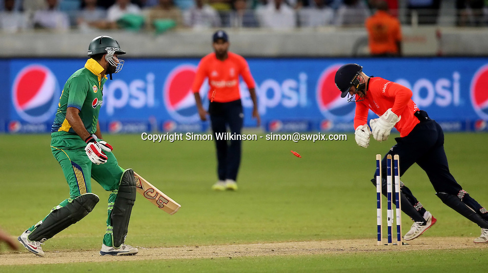 PICTURE BY MARK GREEN/SWPIX.COM  Pakistan v England 1st T20, Dubai Internayional Stadium, UAE, 26/11/15 <br /> Sohaib Maqsood is stumped by Sam Billings from the bowlinf of Moeen Ali