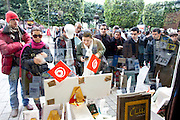 Tunis, Tunisia. January 27th 2011.On the Avenue Bourguiba, people watch the window of the Librairie Al Kitab that shows the books that were forbidden under Ben Ali's regime..A daily life scene outside the protests places, thirteen days after the ousted president Zine El Abidine Ben Ali fled the country......
