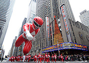 The Red Mighty Morphin Power Ranger, measuring 77 feet long, 26 feet wide and 56 feet tall, soars through the air as one of the longest and tallest balloons in the 2014 Macy's Thanksgiving Day Parade, Thursday, Nov. 27, 2014, in New York. (Photo by Diane Bondareff/Invision for Power Rangers/AP Images)