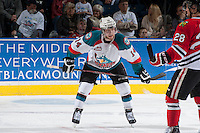 KELOWNA, CANADA - APRIL 25: Rourke Chartier #14 of the Kelowna Rockets stands on the ice against the Portland Winterhawks on April 25, 2014 during Game 5 of the third round of WHL Playoffs at Prospera Place in Kelowna, British Columbia, Canada. The Portland Winterhawks won 7 - 3 and took the Western Conference Championship for the fourth year in a row earning them a place in the WHL final.  (Photo by Marissa Baecker/Getty Images)  *** Local Caption *** Rourke Chartier;