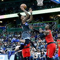 25 February 2017: Orlando Magic guard Elfrid Payton (4) goes for the layup against Atlanta Hawks forward Paul Millsap (4) during the Orlando Magic 105-86 victory over the Atlanta Hawks, at the Amway Center, Orlando, Florida, USA.